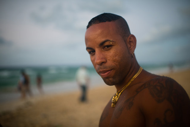 Yosbani Estanque, 24, is pictured at Santa Maria beach, about 15 miles from Havana. It is the closest beach to Havana. Estanque is part of a rap group who were gathered at the beach practicing their songs. The government is demolishing buildings all over the coast of East Havana and recovering and restoring beach dunes. (Photo by Sarah L. Voisin/The Washington Post)