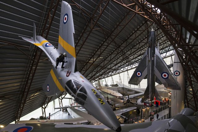 The annual high- level aircraft cleaning and maintenance takes place at the RAF Cosford Museum in Shifnal, England, Tuesday January 2, 2018. The work is carried out by a specialist cleaning company, focusing on the suspended aircraft currently displayed within the Museum' s National Cold War Exhibition. (Photo by Aaron Chown/PA Wire via AP Photo)