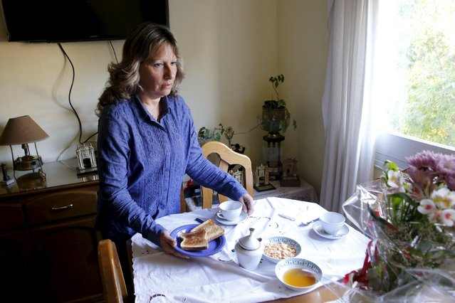 Laura Paipo, first blind principal in Uruguay prepares breakfast for her husband Jorge Albarracin at their home in Montevideo, September 18, 2015. Paipo, 55, who took office on August 10, 2015 became the first blind principal of a special school which specializes in the education of visually impaired students. (Photo by Andres Stapff/Reuters)
