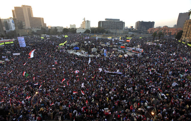 Thousands of Egyptian protesters gather in Tahrir Square, Cairo, on January 25, 2013. Two years after Egypt's revolution began, the country's schism was on display as the mainly liberal and secular opposition held rallies saying the goals of the pro-democracy uprising have not been met and denouncing Islamist President Mohammed Morsi. (Photo by Khalil Hamra/AP Photo/The Atlantic)