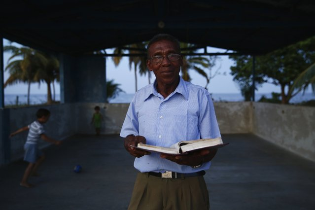 Domingo Rios, an evangelical priest who travels around villages near Maracaibo Lake, poses for a portrait in the village of Ologa in the western state of Zulia October 23, 2014. (Photo by Jorge Silva/Reuters)
