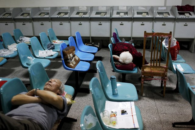 Tang Weiguo (L), takes a nap on chairs at during a mid-day break at a brokerage house in Shanghai, China, June 16, 2015. Some are in it just for the money, others to help buy a meal. Then there are those who trade for fun or to spend time among friends. (Photo by Aly Song/Reuters)