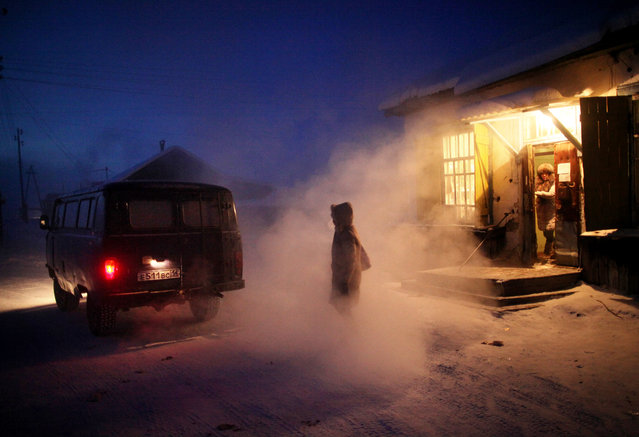"""Locals emerge from the village's only store. Chapple says the store was decorated with children's drawings illustrating the evils of alcohol: """"It was clearly an attempt by the local school to shame Oymyakon's dads into drinking less"""". (Photo by Amos Chapple/Courtesy Images/RFE/RL)"""
