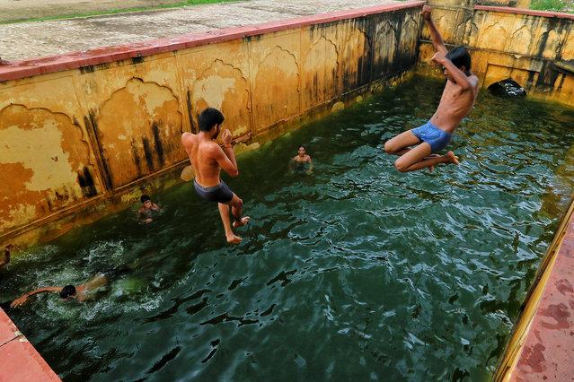 Children jump into a step-well (baori) after it was filled with rain water, near Man Sagar Lake in Jaipur, Rajasthan, India, on September2, 2020. (Photo by Vishal Bhatnagar/NurPhoto via Getty Images)