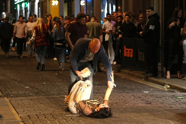 As the night comes to a close and freshers pile out of clubs and bars, some struggle to stay on their feet in Liverpool, United Kingdom on September 21, 2016. (Photo by Paul Jacobs/FameFlynet UK)
