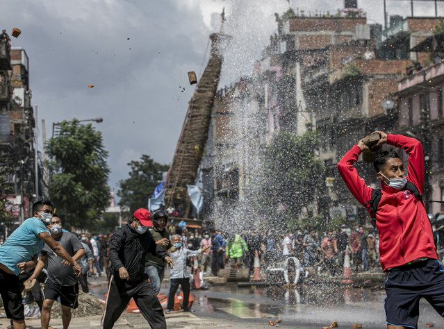 Nepalese devotees and riot police clash ahead of the Rato Machindranath chariot festival procession in Lalitpur, Nepal, 03 September 2020. Hundreds of devotees and riot police clashed when devotees started procession of Rato Machindranath chariot amid coronavirus pandemic lockdown. The Rato Machhindranath festival, which pays homage to the rain diety of the same name, features a procession with a 32-foot high wooden chariot, has been suspended more than a month ago due to the coronavirus pandemic. Previously, thousands of Hindus and Buddhists community celebrated the Ratomachindranath festival by pulling the chariot all over the valley for a month. The festival is celebrated in the hope of a good harvest, prosperity and good luck, for the upcoming year. (Photo by Narendra Shrestha/EPA/EFE/Rex Features/Shutterstock)