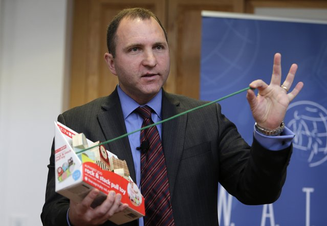 James Swartz, director of World Against Toys Causing Harm Inc., holds up a string on a children's pull toy at Children's Franciscan Hospital in Boston, Wednesday, November 19, 2014. (Photo by Charles Krupa/AP Photo)