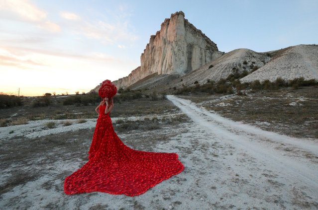 A model presents a creation during a Crimean Fashion Week show near the White Rock, also known as Aq-Qaya, outside Belogorsk, Crimea on September 13, 2020. (Photo by Alexey Pavlishak/Reuters)