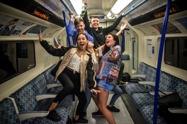 A group of people are seen on a Victoria line train in London, England during the first night of the Night Tube service on August 19 2016. The Central line and Victoria line are the first to operate a Night service with further lines expected to be running by the end of the year. (Photo by SWNS.com)