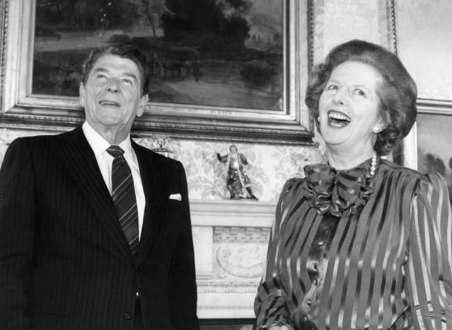 British Prime Minister Margaret Thatcher shares a joke with American President Ronald Reagan, at No. 10 Downing Street, London, 1984. (Photo by Keystone/Getty Images)