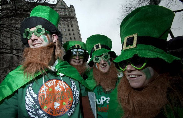 Alan Fitzpatrick (L) from Ireland watches the St. Patrick's Day Parade in New York, March 16, 2013. (Photo by Carlo Allegri/Reuters)