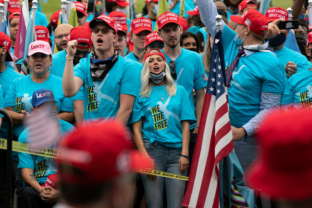 Supporters of President Donald Trump rally at The Ellipse, before entering to The White House, where Trump will hold an event on the South lawn on Saturday, October 10, 2020, in Washington. (Photo by Jose Luis Magana/AP Photo)