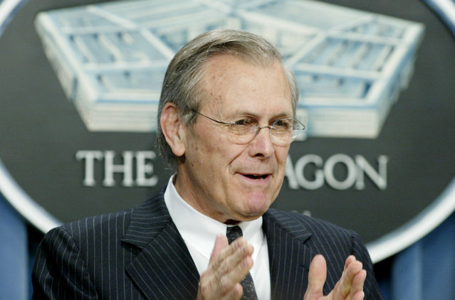 U.S. Defense Secretary Donald Rumsfeld speaks to the press at a Pentagon briefing in Washington, April 9, 2003. Rumsfeld praised the progress of American-led forces fighting in Iraq but warned the fighting would continue and the military still needed to account for Iraqi President Saddam Hussein. (Photo by Rick Wilking/Reuters/The Atlantic)