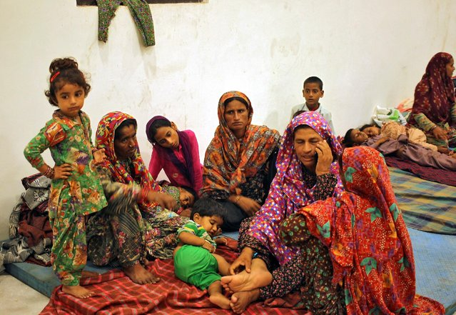 Villagers sit inside a relief camp after they evacuated their village near the border with Pakistan in Ranbir Singh Pora, southwest of Jammu, September 30, 2016. (Photo by Munish Sharma/Reuters)