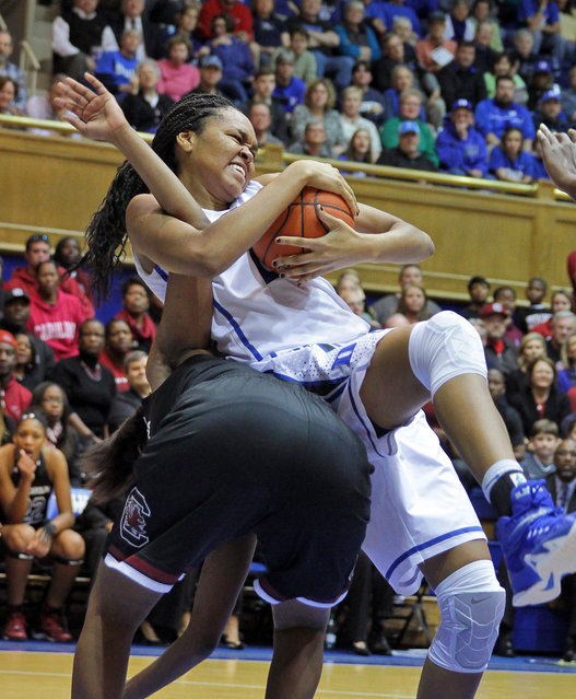 Duke's Azura Stevens grabs a rebound from South Carolina's Tina Roy during an NCAA college basketball game in Durham, N.C., Sunday, December 7, 2014. (Photo by Ted Richardson/AP Photo)