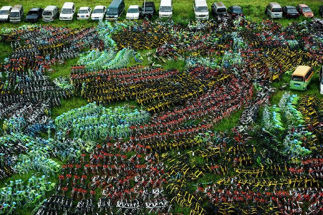 Bicycles of various bike-sharing services are seen at an urban village in Hangzhou, Zhejiang province, China, 2017. (Photo by Reuters/China Stringer Network)