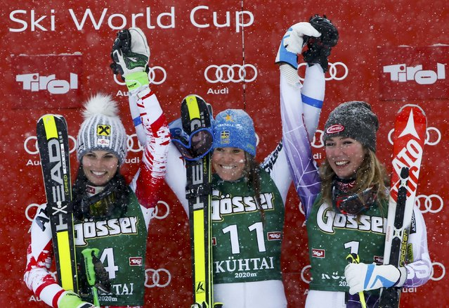 Anna Fenninger from Austria, Sara Hector from Sweden and Mikaela Shiffrin (L-R) from the U.S. react on the podium after the World Cup Women's Giant Slalom race in Kuehtai ski resort December 28, 2014. (Photo by Leonhard Foeger/Reuters)