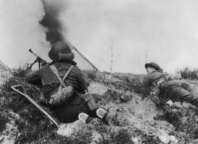 Soldiers from a Canadian regiment take up firing positions behind a canal bank in Holland, 17th April 1945. (Photo by Keystone/Hulton Archive/Getty Images)