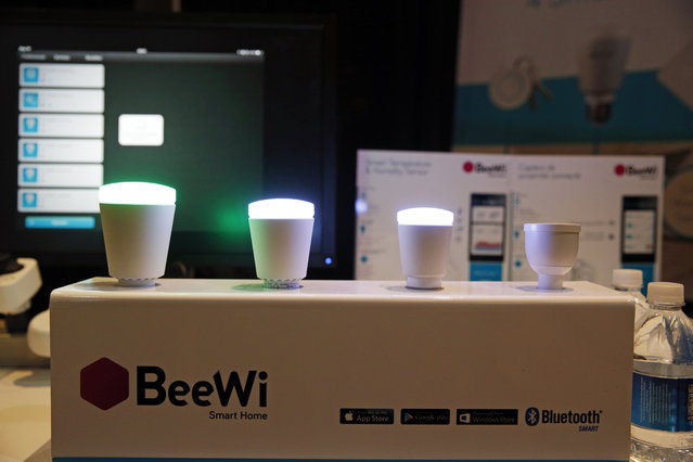 BeeWi wirelessly controlled lights are on display at CES Unveiled, a media preview event for CES International, Sunday, January 4, 2015, in Las Vegas. (Photo by John Locher/AP Photo)