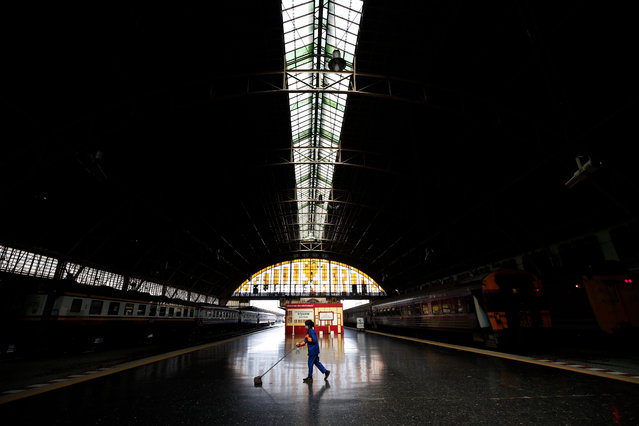 "A worker cleans the floor ahead of the returning of travelers from New Year holiday amid the new wave of COVID-19 coronavirus pandemic, at Hua Lamphong railway station in Bangkok, Thailand, 03 January 2021. The Thai government has declared stricter health measures with ordering nationwide partial business shutdowns for 28 ""red zones"" provinces including Bangkok and pledged with the public not to travel to curb a new wave of COVID-19 coronavirus pandemic which hundreds of new coronavirus cases have been confirmed daily. (Photo by Rungroj Yongrit/EPA/EFE)"