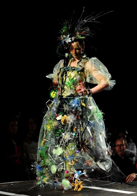 A model presents a creation during Trash Fashion Show in Macedonia's capital Skopje, on Wednesday, June 5, 2013. Teams from 47 high schools from Macedonia participated in the show with creations made of redesigned materials from waste such as  plastic bags, newspapers, cardboard, plastic bottles, cans, used paper, etc. (Photo by Boris Grdanoski/AP Photo)