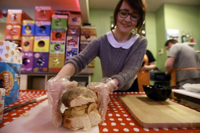 A member of staff prepares herself a crisp sandwich in the Simply Crispy sandwich cafe in Belfast, northern Ireland January 12, 2015. The sandwich shop which opened on Monday is the world's first crisp sandwich cafe, local media reported. The idea of a crisp sandwich cafe started as a joke article on a website called Ulster Fry.(Photo by Cathal McNaughton/Reuters)