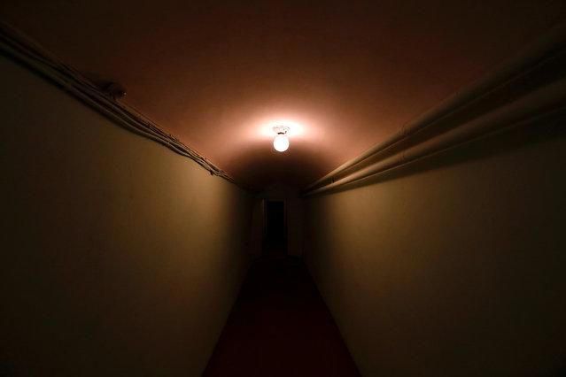 A lamp illuminates a corridor inside Stalin's Bunker in Samara, Russia, on Tuesday, June 26, 2018. (Photo by David Gray/Reuters)