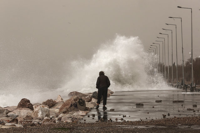 Huge waves hit a promenade at Floisvos suburb, west of Athens, Sunday, February 1, 2015. Heavy rain and severe winds reaching speeds of up to 10 Beaufort hit many areas throughout the country, causing damage to infrastructure and localised flooding. (Photo by Yorgos Karahalis/AP Photo)