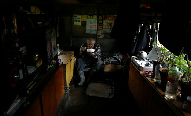 Charcoal burner Zygmunt Furdygiel eats soup inside his hut at a charcoal making site in the forest of Bieszczady Mountains, near Baligrod village, Poland November 6, 2016. (Photo by Kacper Pempel/Reuters)