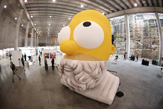 "The inflatable installation ""Homer Homer"" is seen at opening night of The Other Art Fair at Barangaroo Reserve on March 18, 2021 in Sydney, Australia. (Photo by Mark Metcalfe/Getty Images)"