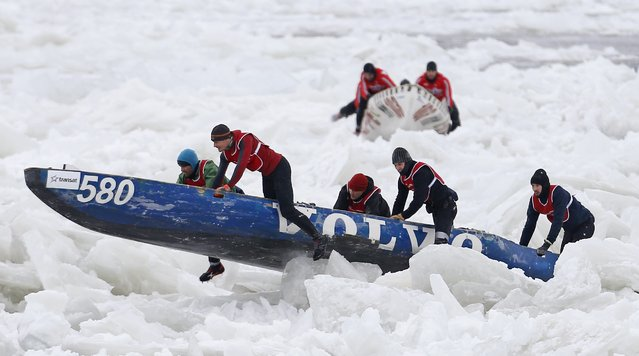 Team Volvo competes during the Quebec Winter Carnival ice canoe race on the St. Lawrence River in Quebec City, February 8, 2015. (Photo by Mathieu Belanger/Reuters)