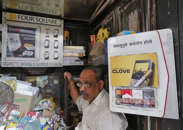 A shopkeeper selling cigarettes waits in his store at a market in Mumbai, India, January 6, 2016. A parliamentary panel in India reviewing whether to put larger health warnings on cigarette packets has asked the health ministry for evidence to show that such a move would cut tobacco consumption, according to documents reviewed by Reuters. (Photo by Shailesh Andrade/Reuters)