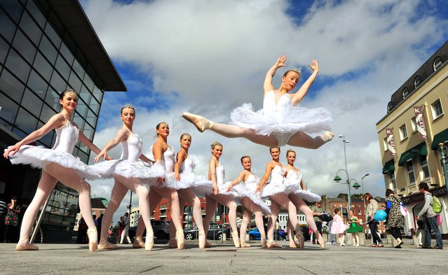 Sophie O'Leary, Cork School of Dance flying through the air at Emmet Place, Cork during the Cork City Ballet 21st year celebration's, on September 21, 2013. (Photo by Dan Linehan)