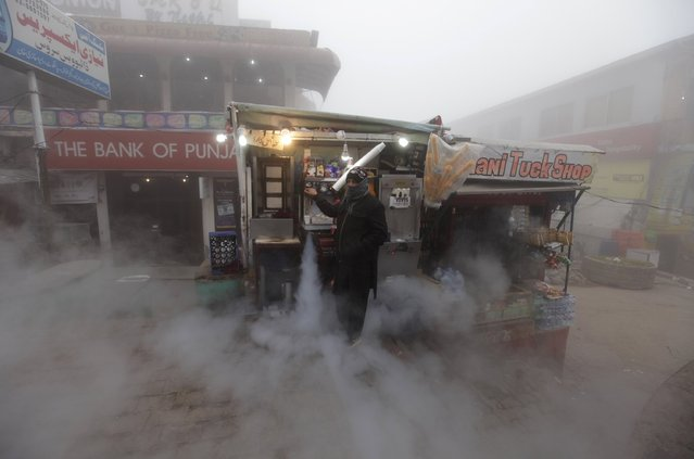 A man waits for customers while selling coffee on a foggy cold winter day in the hill-resort town of Murree, northeast of capital Islamabad, Pakistan, January 12, 2016. (Photo by Faisal Mahmood/Reuters)