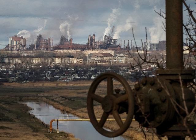 Smoke billows from the chimneys of the Ilycha steelworks in the industrial city of Mariupol in eastern Ukraine February 3, 2015. (Photo by Gleb Garanich/Reuters)