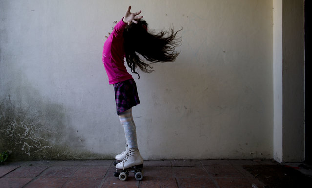 "In this September 29, 2015, file photo, Luana poses for photos on her roller skates at her home in Merlo, Argentina. Luana says that when one of the girls asked her why she had a pen*s, a friend jumped in. ""She's transsexual"", the child explained, nonchalantly. That level of comfort is no doubt in part because Luana herself appears so at ease. In 2013, she became the youngest person to take advantage of a progressive Argentine law that allows people to identify their own gender for legal purposes. (Photo by Natacha Pisarenko/AP Photo)"