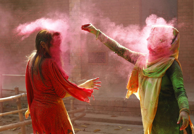 Bangladeshi students throw colored powder on each other during the Holi Festival in Dhaka, Bangladesh, 08 March 2015. Holi, which literally means 'burning', is celebrated on the full moon day in the month of Phalguna and heralds the onset of spring season.  EPA/ABIR ABDULLAH