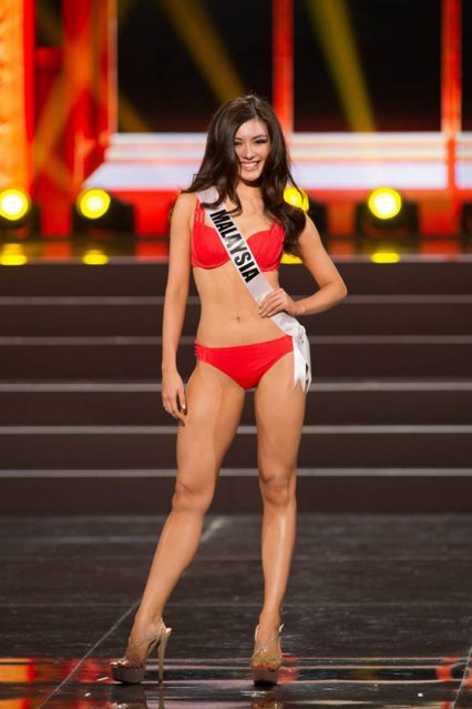 A handout picture provided by the Miss Universe Organization shows Carey Ng, Miss Malaysia 2013, competing in the swimsuit competition during the Preliminary Competition at the Crocus City Hall, in Moscow, Russia, 05 November 2013. (Photo by Darren Decker/EPA)