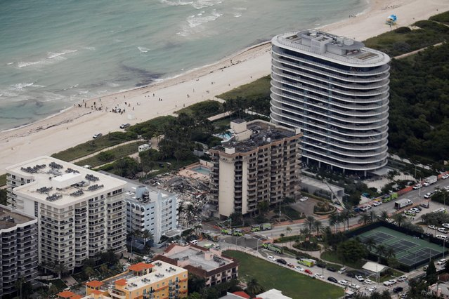 An aerial view showing a partially collapsed building in Surfside near Miami Beach, Florida, U.S., June 24, 2021. (Photo by Marco Bello/Reuters)