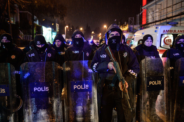 Turkish police officers block the road leading to the scene of an attack in Istanbul, early Sunday, January 1, 2017. (Photo by Depo Photos via AP Photo)