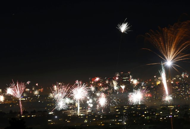 Fireworks explode over Vienna's skyline during New Year celebration in Vienna, Austria, January 1, 2017. (Photo by Leonhard Foeger/Reuters)