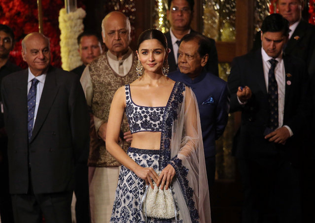 Actress Alia Bhatt arrives to attend the wedding ceremony of Isha Ambani, the daughter of the Chairman of Reliance Industries Mukesh Ambani, in Mumbai, India, December 12, 2018. (Photo by Francis Mascarenhas/Reuters)