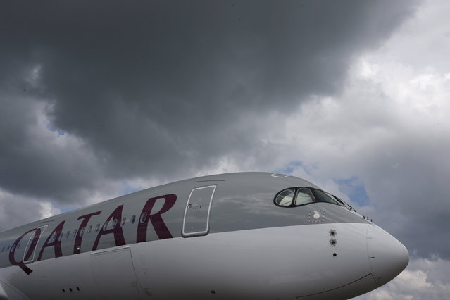 A Qatar Airways Airbus A350 XWB aircraft is displayed at the Singapore Airshow at Changi Exhibition Center February 18, 2016. (Photo by Edgar Su/Reuters)