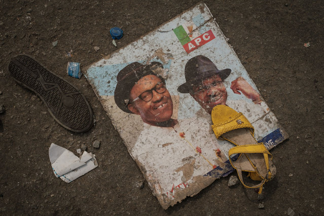 This picture taken on February 13, 2019, shows shoes and items lying on the ground in front of the main entrance of the Adokiye Amiesimaka Stadium where fifteen people were killed on February 12, 2019 in a stampede during an election campaign rally held by Nigerian President in Port Harcourt, Southern Nigeria. The deaths are the latest on the campaign trail before February 16 election, at which Buhari is seeking a second, four-year term of office. (Photo by Yasuyoshi Chiba/AFP Photo)