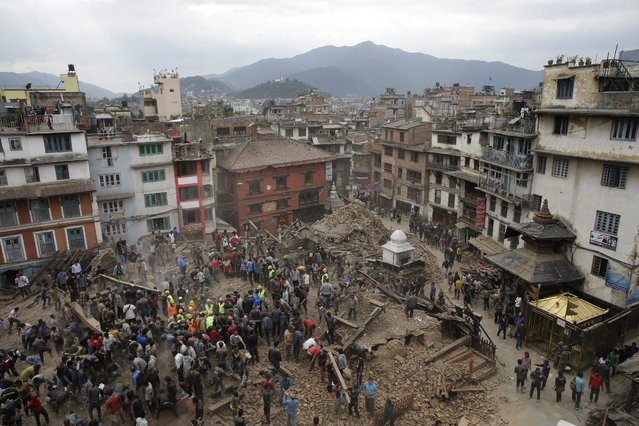 People search for survivors under the rubble of collapsed buuildings in Kathmandu Durbar Square, after an earthquake caused serious damage in Kathmandu, Nepal, 25 April 2015. (Photo by Narendra Shrestha/EPA)