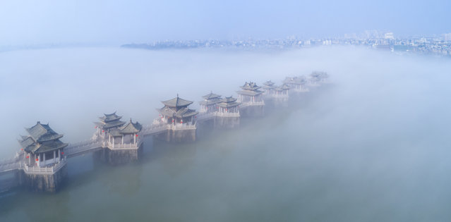 Buildings are seen in heavy fog at Guangji Bridge on March 21, 2019 in Chaozhou, Guangdong Province of China. (Photo by Lin Wenqiang/VCG via Getty Images)