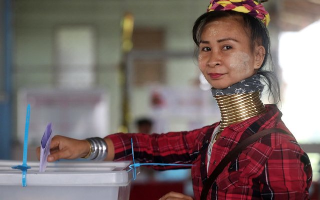 An ethnic Kayan woman, also known as a long neck villager casts her vote for the general election in Mae Hong Son, Thailand, March 24, 2019. (Photo by Ann Wang/Reuters)