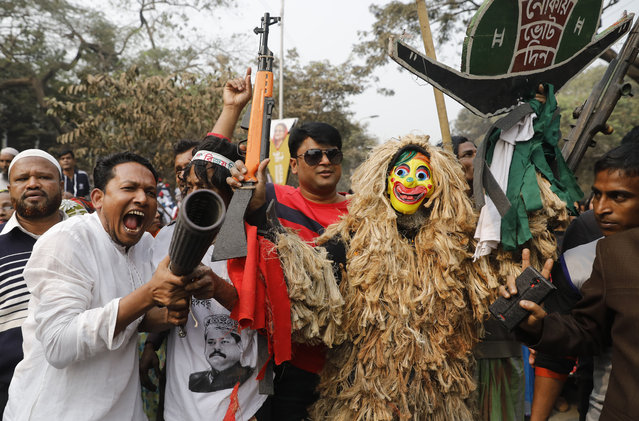Supporters of the Awami League political party play with toy guns during a rally celebrating the party's overwhelming victory in last month's election in Dhaka, Bangladesh, Saturday, January 19, 2019. (Photo by AP Photo/Stringer)