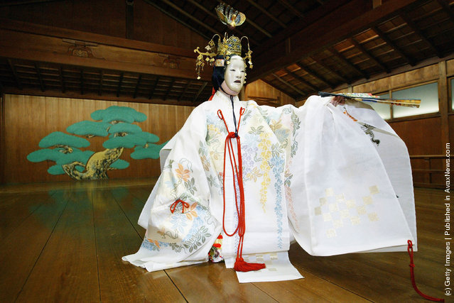 A traditional Japanese Noh actor gets his masks and costumes put on prior to demostrating a performance of the ancient theatrical art