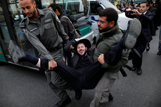 Ultra-Orthodox Jewish protestor is detained by an Israeli border policemen during a demonstration against members of their community serving in the Israeli army, part of ongoing demonstrations recently seen throughout Israel, in Jerusalem February 9, 2017. (Photo by Ammar Awad/Reuters)